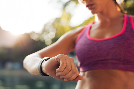 Runner checking her fitness smart watch device
