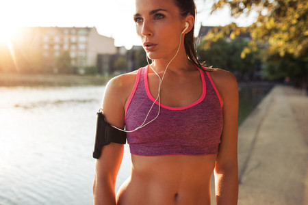 Determined young sportswoman training outdoors