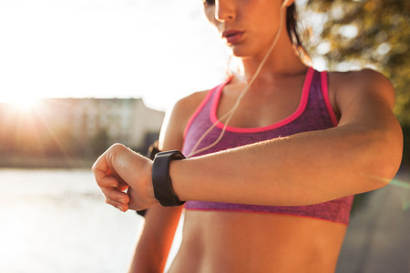 Sporty young woman checking pulse