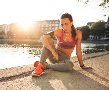 Female runner taking a rest from training