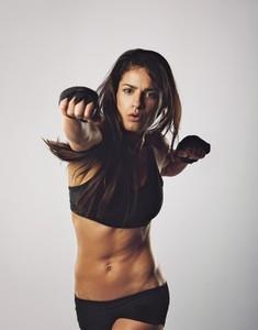 Female boxer boxing punch towards camera