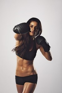 Female athlete exercising boxing