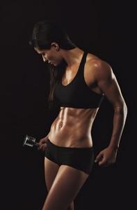 Muscular female doing bodybuilding training