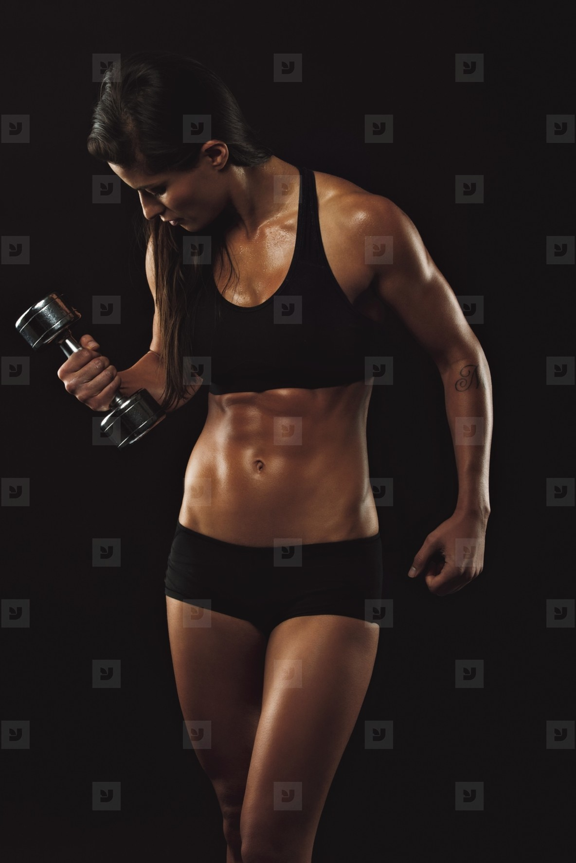 Fitness woman lifting hand weight