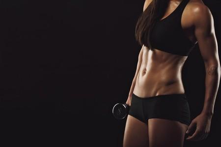 Muscular woman lifting weight
