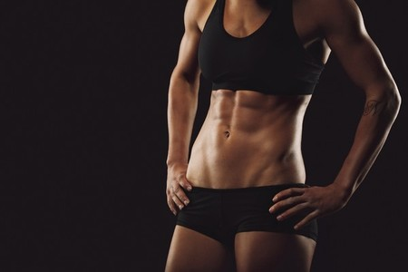 Woman body with muscular abs