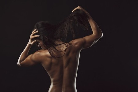 Topless female with muscular body