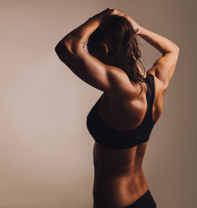 Fitness female showing muscular back