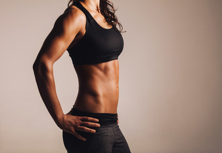 Female with perfect abdomen muscles