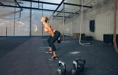 Young fitness female doing crossfit workout
