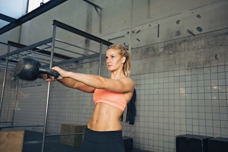 Fitness woman doing crossfit exercise