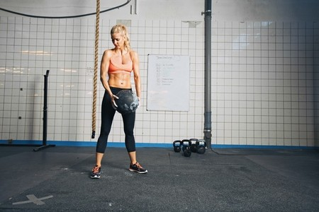 Fitness woman working out with a medicine ball