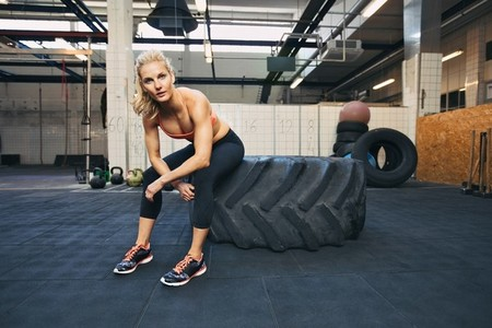 Young woman taking rest after crossfit workout