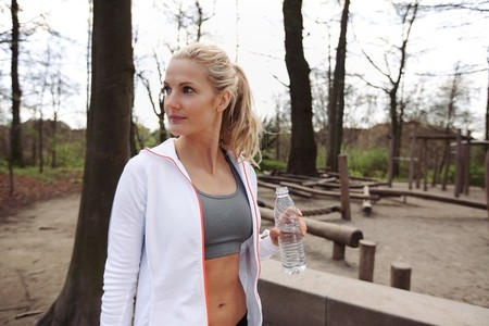 Young woman after working out at a park