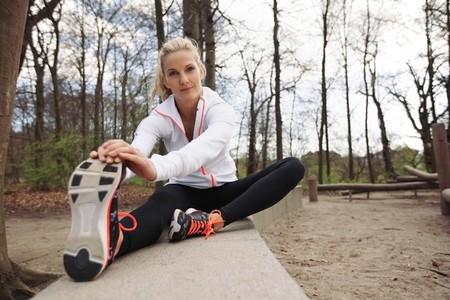 Beautiful female stretching before running