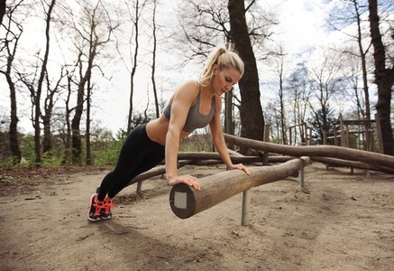 Fit young lady exercising in park
