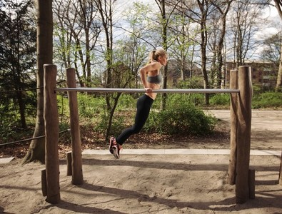 Fitness female doing parallel bar dips