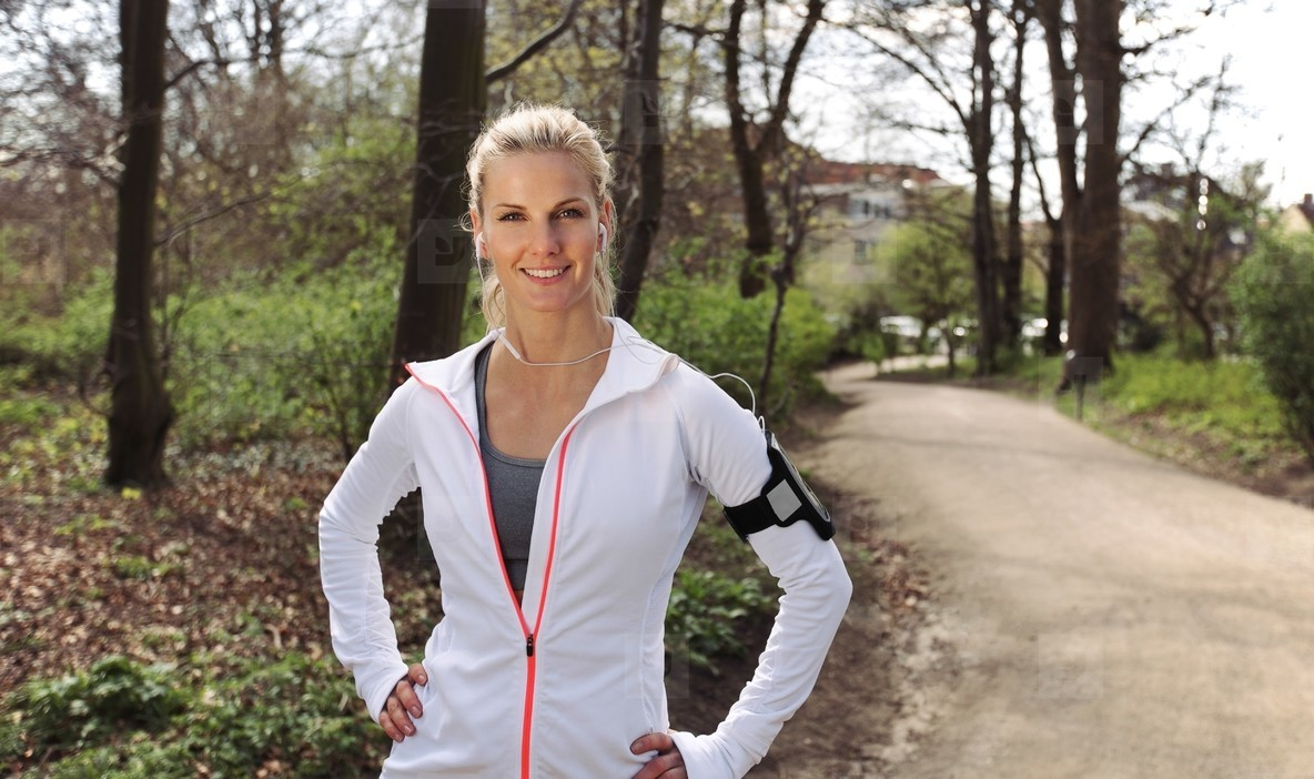 Beautiful and confident female runner outdoors