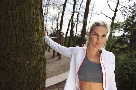 Fitness female resting after outdoors training
