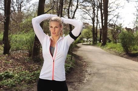 Focused female runner in forest