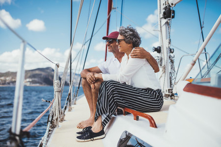 Happy mature couple enjoying a boat ride together