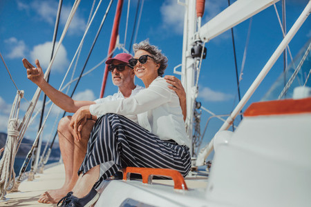 Relaxed mature couple on a yacht
