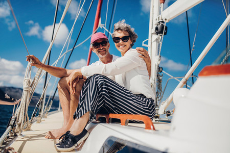 Senior couple having great time on yacht