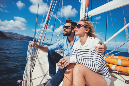 Relaxed young couple sailing