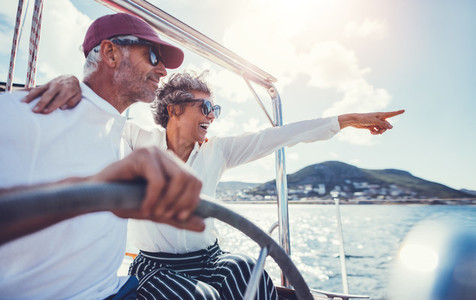 Happy senior couple having fun on a boat trip