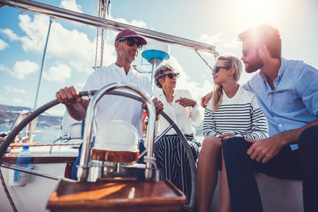 Group of people hanging out together on a sailboat