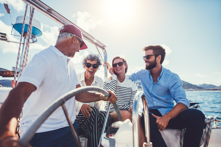 Family enjoying a summer day on a yacht