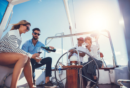 Group of friends drinking wine on a yacht