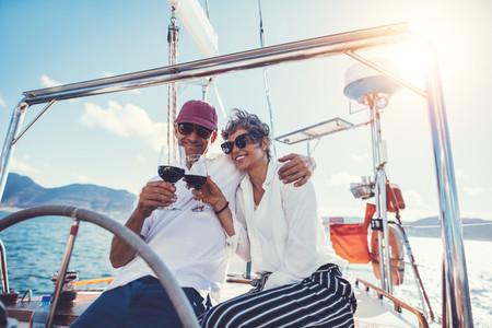 Senior couple enjoying wine on boat deck