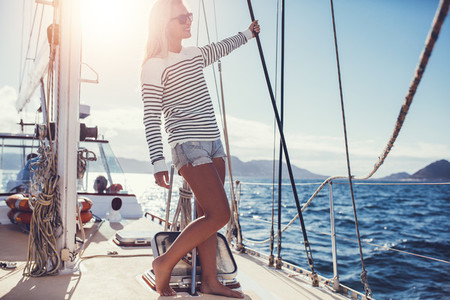 Young woman enjoying summer holidays on a boat