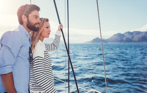 Young couple enjoying the view from a sailboat