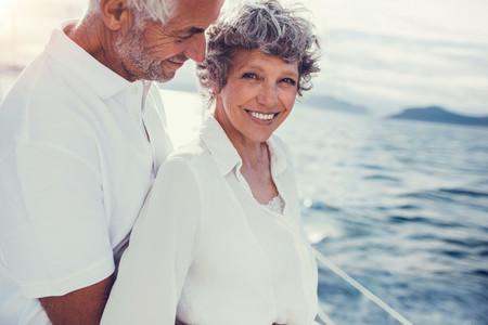Senior couple enjoying their summer holidays on boat trip
