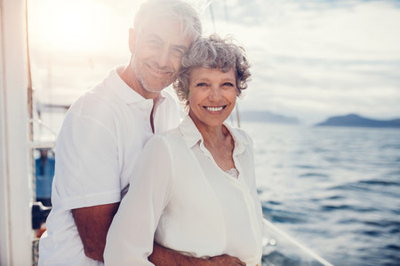 Loving mature couple standing on boat