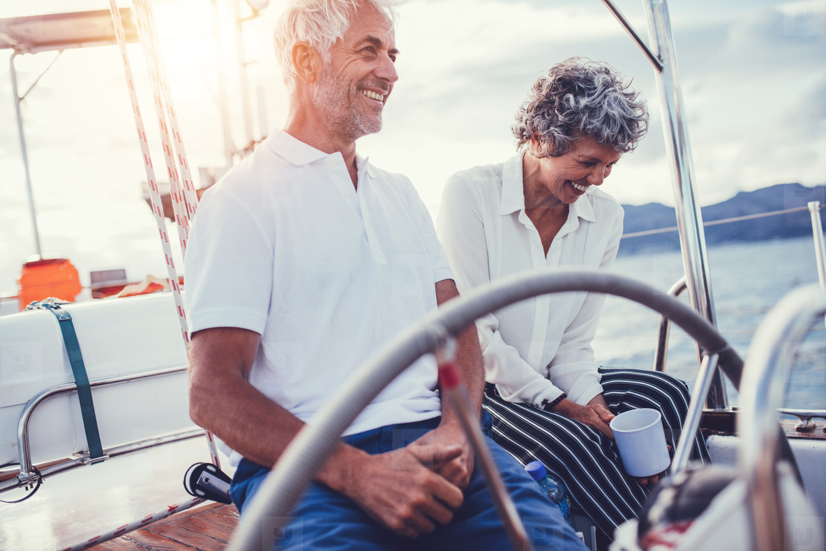 Senior couple sitting on the deck of a boat