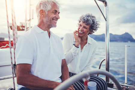 Happy relaxed couple on the boat