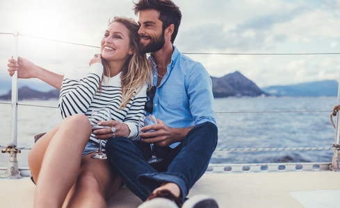 Loving couple on a romantic getaway on a boat