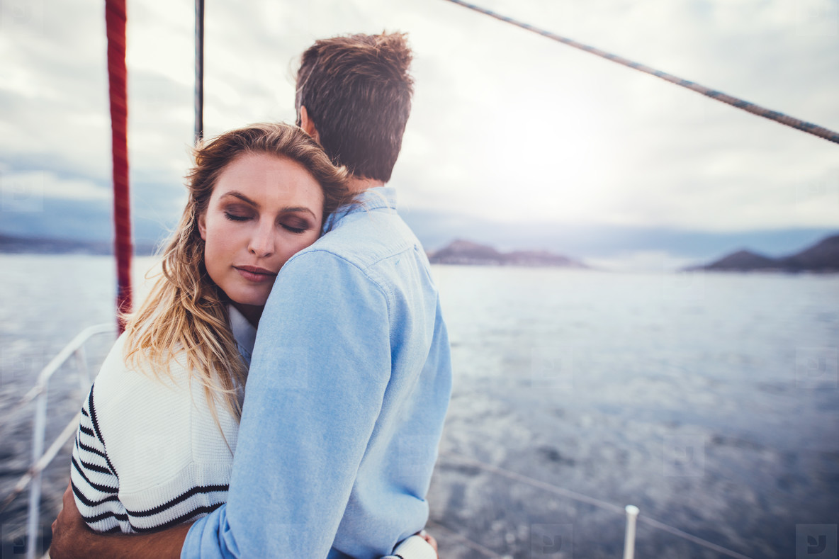 Affectionate couple in romantic getaway on a yacht