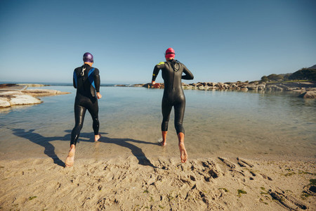 Triathletes practicing for triathlon competition