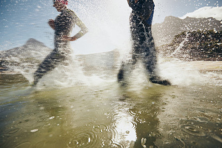 Athletes training for triathlon race