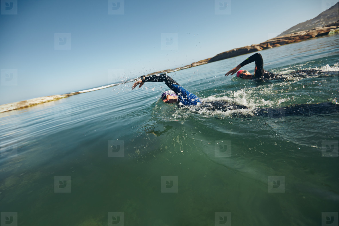 Athletes swimming on triathletic competition
