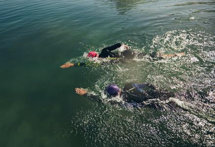 Triathlon participants practicing for swim event