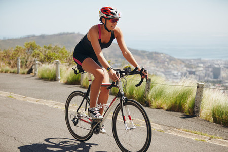 Woman cyclist practicing for triathlon competition