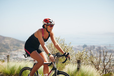 Female cyclist riding racing bicycle