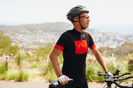 Male cyclist on countryside