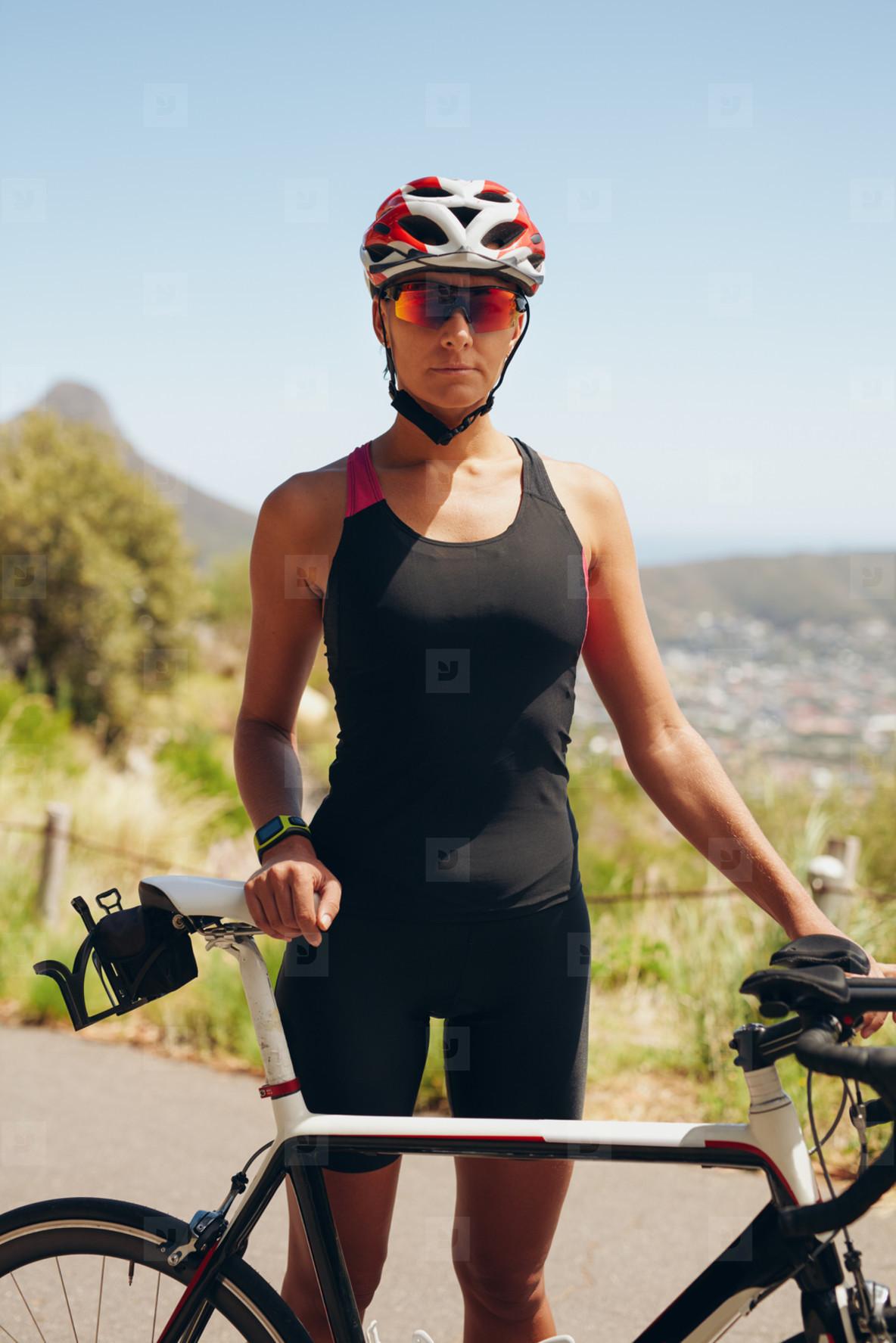 Female cyclist preparing for triathlon