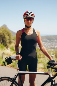 Female cyclist preparing for triathlon